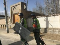 'Eradicate the tumours': Chinese civilians drive Xinjiang crackdown