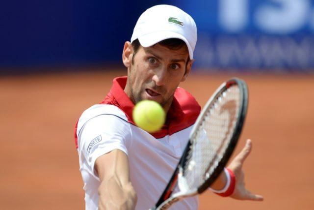 Novak Djokovic suffered a surprise defeat at the hands of Martin Klizan in Barcelona