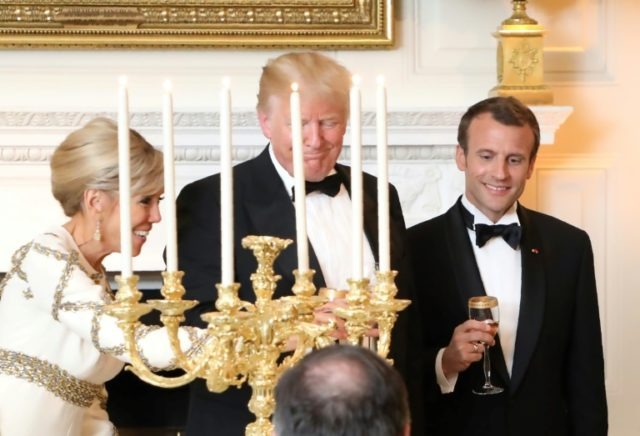 US President Donald Trump and French President Emmanuel Macron toast during a state dinner at the White House