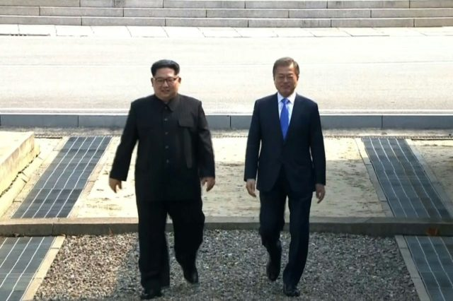 The two leaders came together and shook hands in the Demilitarized Zone