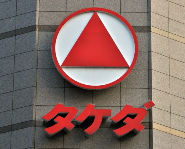 Some analysts say a takeover bid of this magnitude could put too much pressure on the finances of Takeda, whose logo is seen here