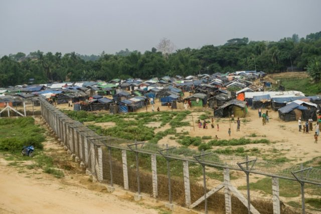 "Rohingya refugees are seen at a temporary settlement setup in a ""no man's land"" border zone between Myanmar and Bangladesh"