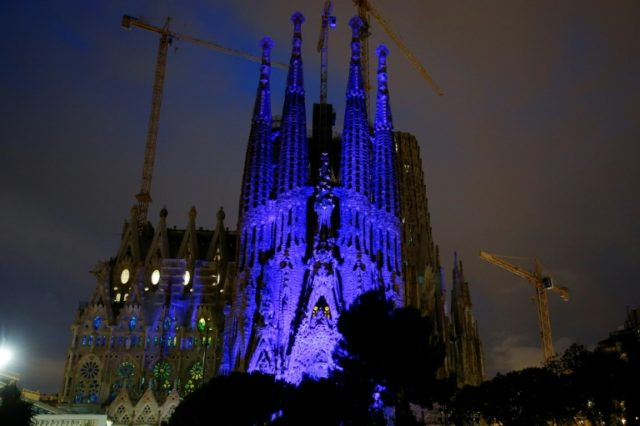 Spain's Sagrada Familia basilica is lit in blue to mark International Autism Day in Barcelona on April 2, 2018.