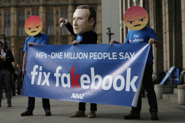 Protestors demonstrated outside Portcullis house in London where Facebook's Chief Technology Officer Mike Schroepfer was grilled by British lawmakers on Thursday