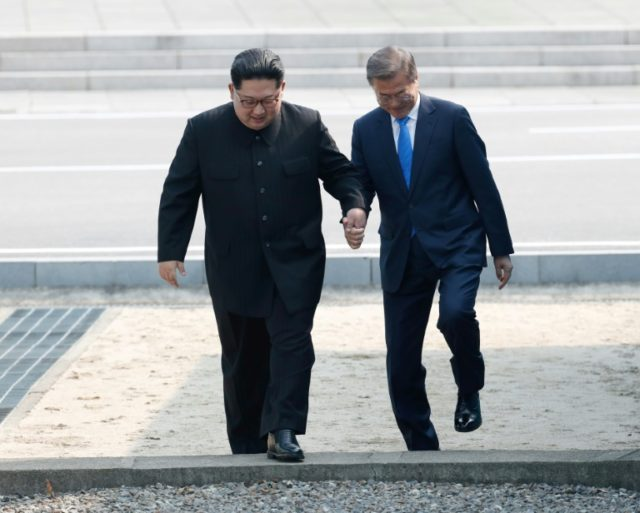 You put your left foot in: Kim Jong Un and Moon Jae-in were engaged in a metaphorical and literal diplomatic dance on Friday when they met at the frontier
