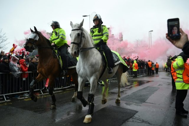 Mounted police escort a coach carrying the Liverpool team to the Champions League first leg semi-final against Roma at Anfield stadium