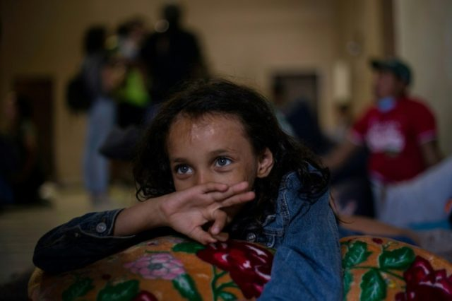 Ashley, an eight-year-old Honduran girl, rests at a shelter in Mexicali on her way to the US as part of a caravan of Central Americans