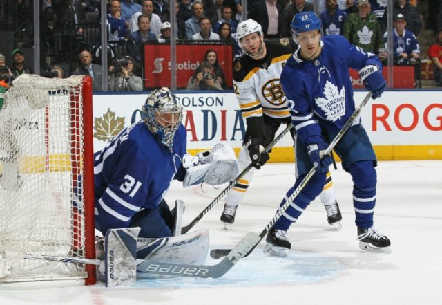 Nikita Zaitsev (R) and Frederik Andersen of the Toronto Maple Leafs defends the net in a series-levelling 3-1 win over the Boston Bruins