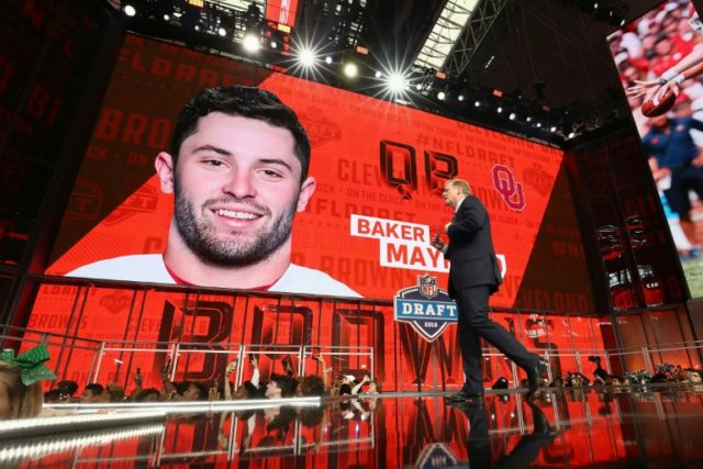 NFL Commissioner Roger Goodell walks past a video board displaying an image of Baker Mayfield of Oklahoma after he was picked #1 overall by the Cleveland Browns during the first round of the 2018 NFL Draft