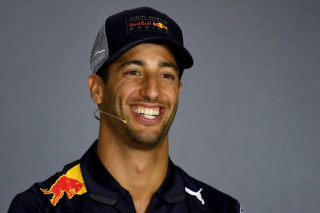 No deal: Red Bull's Australian driver Daniel Ricciardo attends a press conference in Baku where he denied he has a deal to switch to Ferrari