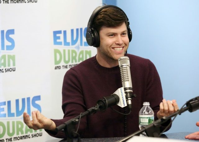 """""""Saturday Night Live"""" comedian Colin Jost -- shown here making an appearance on a New York radio show in 2016 -- will co-host the Emmys with colleague Michael Che"""