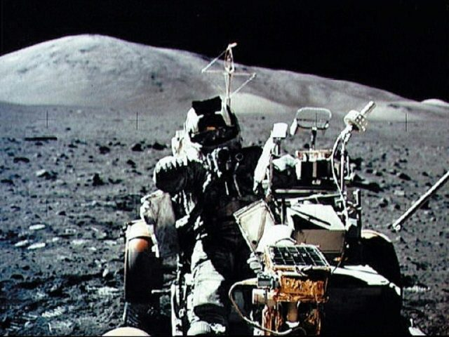 A NASA picture taken by US crew commander Eugene A. Cernan during the Apollo 17 mission on December 13, 1972 shows astronaut and geologist Harrison H. Schmitt seated in the Lunar Roving Vehicle on the surface of the moon