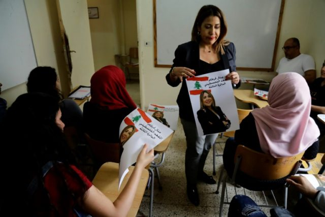 Palestinian refugee Manal Kortam talks to students at the Mar Elias Palestinian refugee camp in Beirut on April 26, 2018