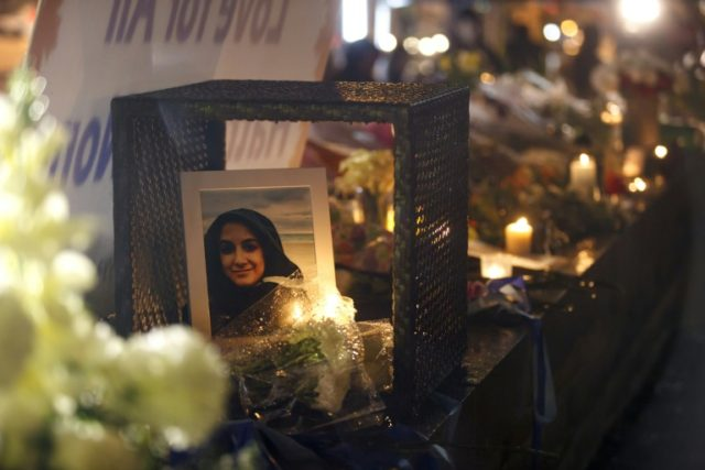 A photograph of Anne Marie D'Amico, one of eight female victims of the mass killing by a van driver, is shown at a vigil in Toronto