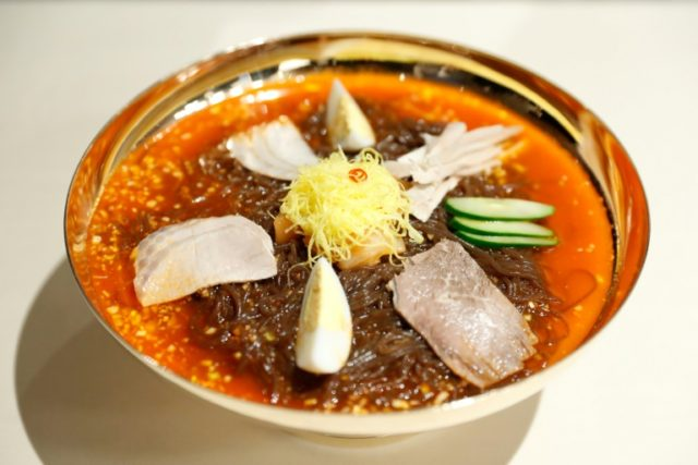 "A cold noodle dish served in a cool mild broth, ""Pyongyang naengmeyon"" is usually garnished with pieces of meat and vegetables"