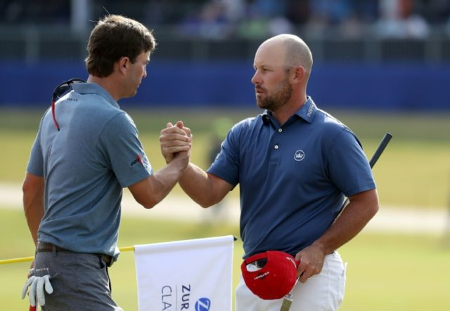 Kevin Kisner and Scott Brown shake hands as they finish their round on the 18th green during the third round of the Zurich Classic on April 28, 2018 in Avondale, Louisiana