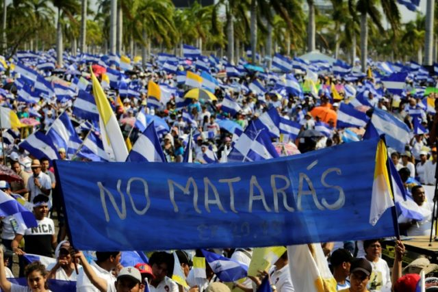 """You shall not kill"" reads a banner carried by demonstrators marching peacefully through Nicaragua's capital to demand justice after the brutal repression of a wave of protests left 43 dead"