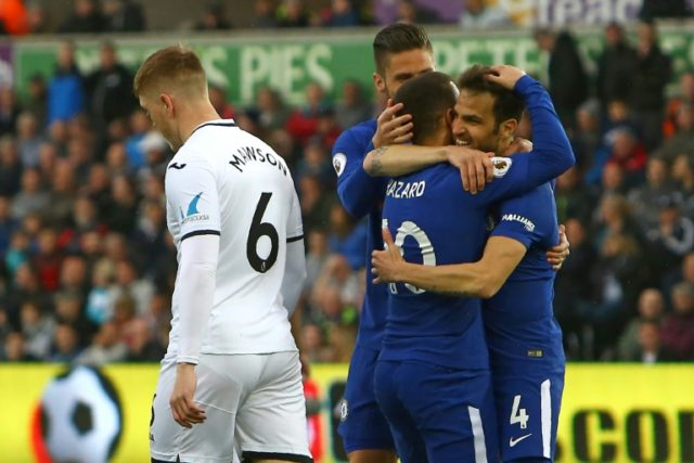 Cesc Fabregas (R) celebrates with Chelsea teammates after scoring his first goal since August to secure a precious 1-0 win at Swansea