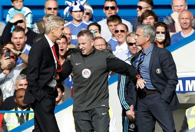 Arsene Wenger and Jose Mourinho had to be pushed apart by fourth official Jonathan Moss when Arsenal and Chelsea met in 2014