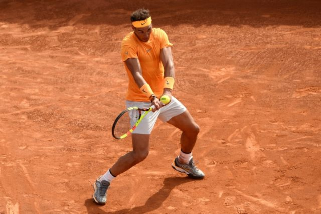 King of clay: Rafael Nadal returns the ball to David Goffin