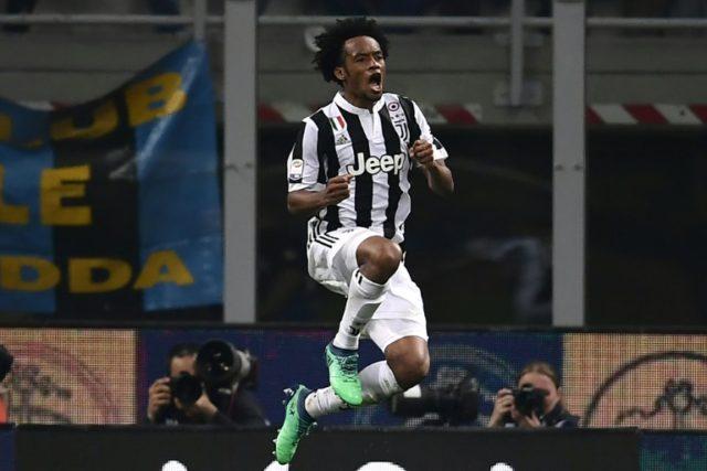 Jump for joy: Juventus' Colombian midfielder Juan Cuadrado celebrates the dramatic 3-2 win