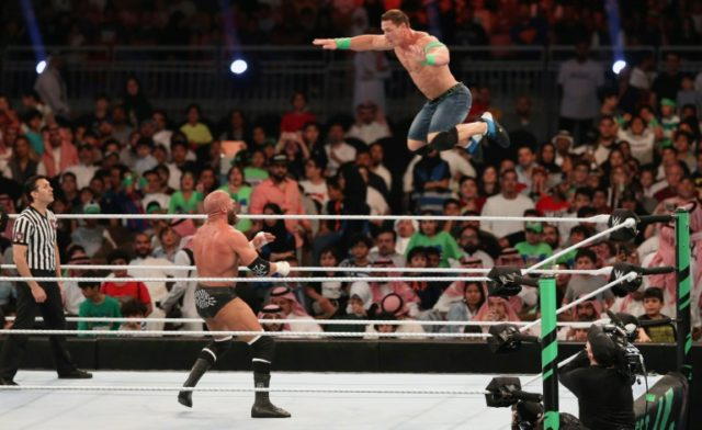 John Cena (R) competes with Triple H during the World Wrestling Entertainment (WWE) Greatest Royal Rumble event in the Saudi coastal city of Jeddah