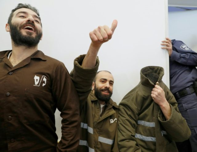 French national Romain Franck (R), a worker at the French consulate, and Palestinians Moufak al-Ajluni (L) and Mohamed Katout (C) appear in court in the Israeli city of Beersheba on March 19, 2018, to face charges of smuggling guns from Gaza
