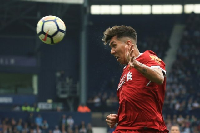 New deal: Liverpool midfielder Roberto Firmino has penned a long-term contract at Anfield