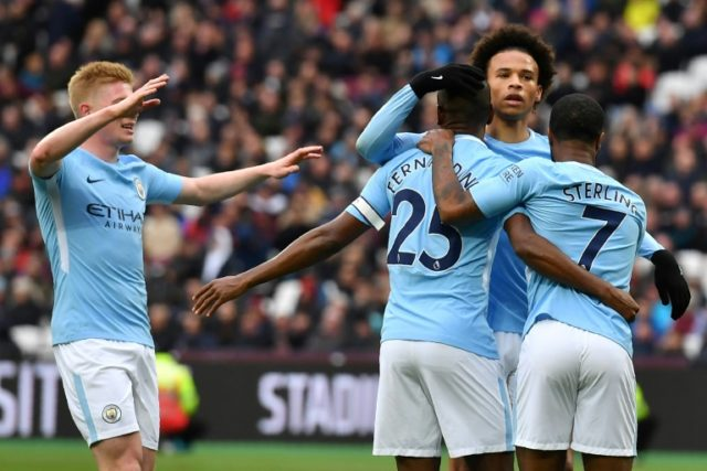 Manchester City midfielder Fernandinho (C) celebrates scoring the champions' fourth goal during Sunday's 4-1 win over West Ham at The London Stadium