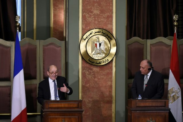 French Foreign Minister Jean-Yves Le Drian (L) speaks during a joint press conference with his Egyptian counterpart Sameh Shoukry in the capital Cairo on April 29, 2018