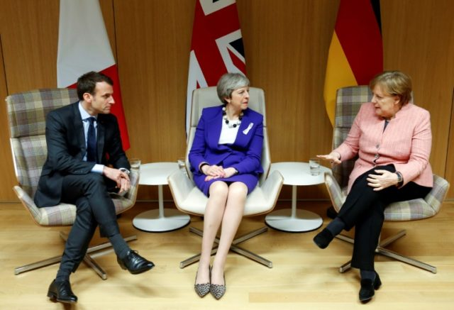 "British Prime Minister Theresa May (C), German Chancellor Angela Merkel (R) and French President Emmanuel Macron, pictured in March 2018, said they ""hope the United States doesn't take measures contrary to transatlantic interests"""