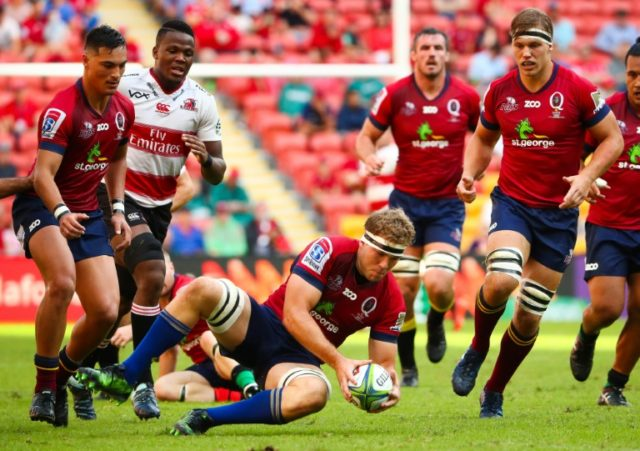 Queensland Reds' Angus Scott-Young dives onto a loose ball during his side's win against the Golden Lions in Brisbane