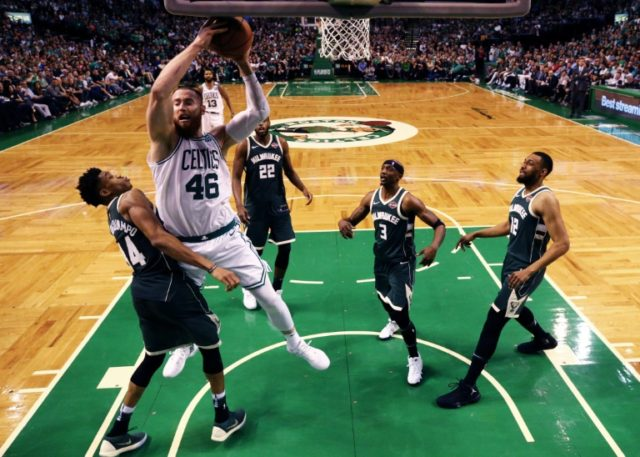 Aron Baynes of the Boston Celtics grabs a rebound over Giannis Antetokounmpo of the Milwaukee Bucks as Boston routed the Bucks 112-96 in game seven to book their spot in the second round of the playoffs