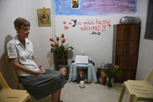 Australian nun Patricia Fox, who faces deportation, prays in a mini-chapel at her residence in Manila