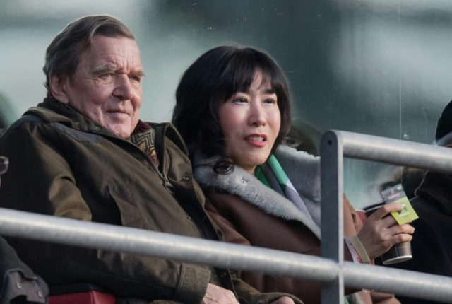 Former German Chancellor Gerhard Schroeder and his South Korean partner Kim So-yeon, pictured at a football match in Germany in February