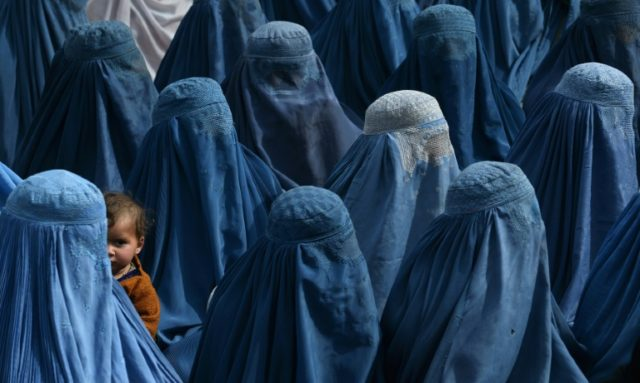 Shah Marai had for more than 15 years been documenting Afghanistan - including this 2014 photo of women at an election rally