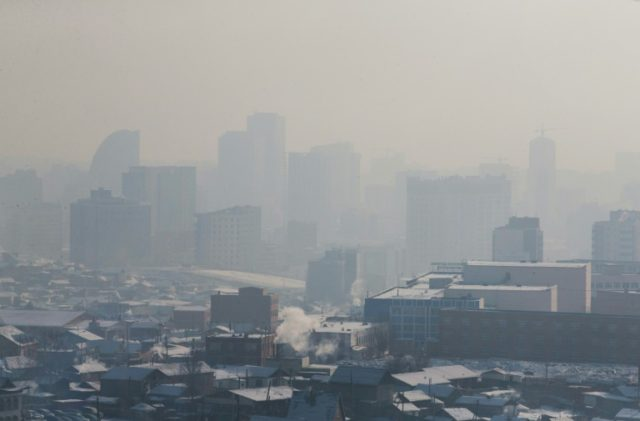 Buildings disappear in the smog in Ulaanbaatar, where residents have resorted to sipping 'lung' tea and 'oxygen cocktails' in a desperate bid to protect themselves from pollution