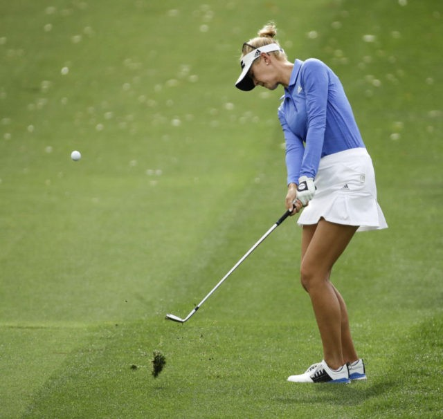 The Latest: Korda holes out for eagle to take LPGA lead