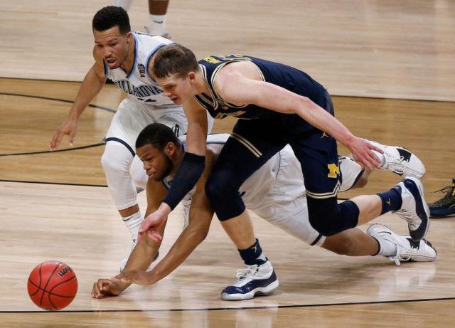 NCAA Latest: AP Player of Year Brunson has four fouls