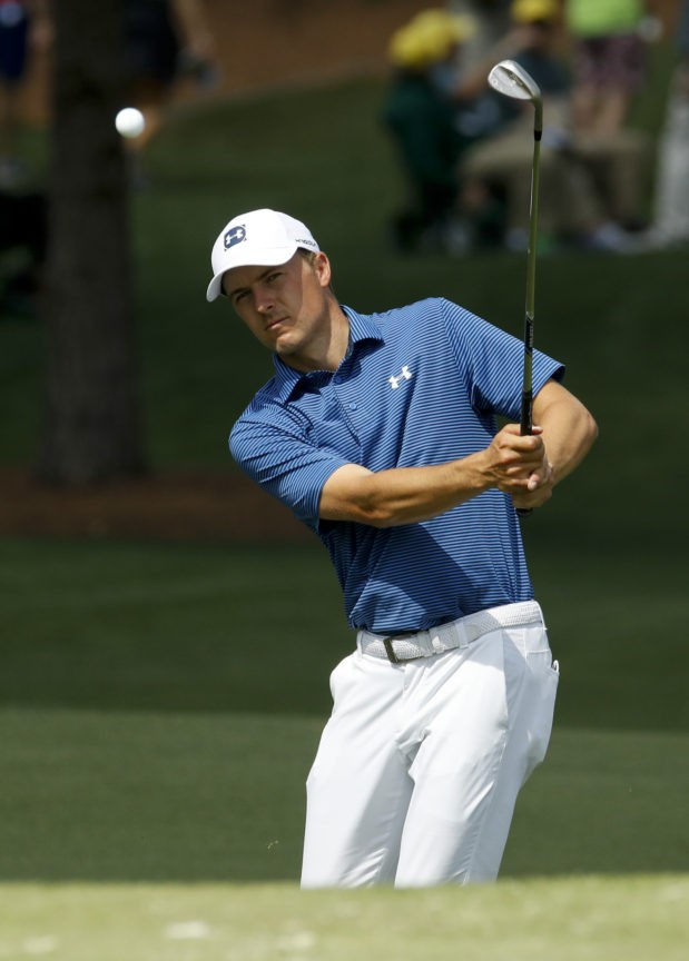 The Latest: Spieth feels calm, confident after putting panic