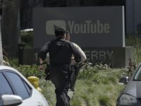 Officers run toward a YouTube office in San Bruno, Calif., Tuesday, April 3, 2018. Police and federal officials have responded to reports of a shooting Tuesday at YouTube headquarters in Northern California. (AP Photo/Jeff Chiu)