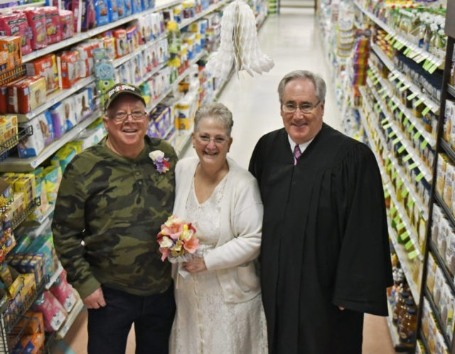 Couple who met in supermarket marry amid veggies in aisle 13