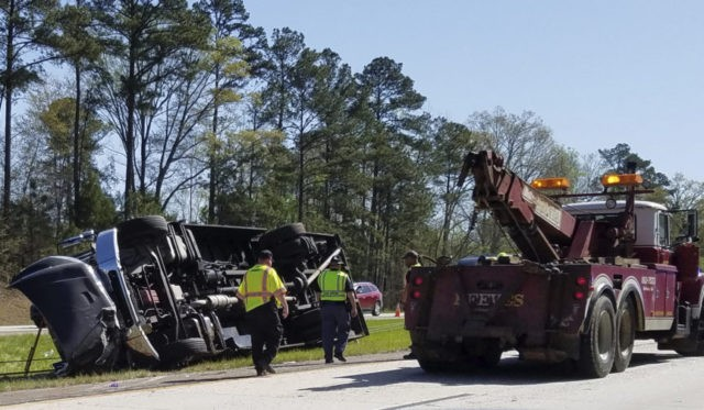 The Latest: Driver worried Masters patrons before bus crash