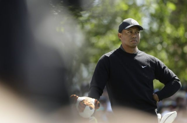 Woods back at Masters, playing with early leader Leishman