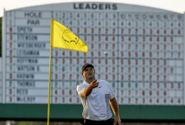 The Latest: Reed halfway home to first major at Masters