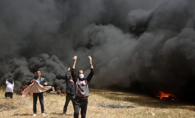 The Latest: Palestinian journalist dies from gunshot wounds