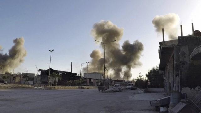 Activists, medics: Gas attack near Syrian capital kills 40