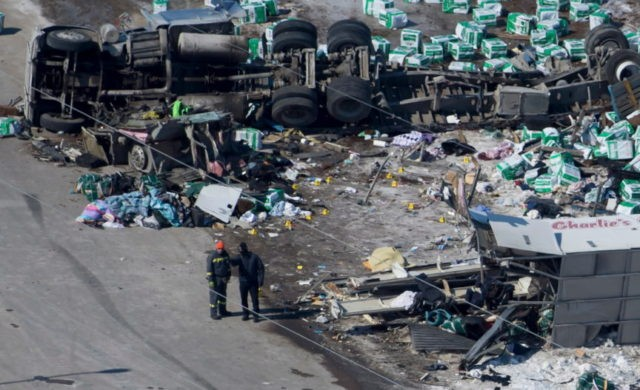 15 die when truck collides with hockey team's bus in Canada