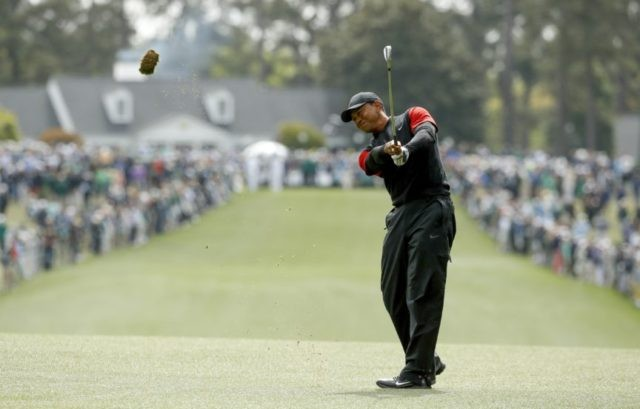 The Latest: Woods finds form, finishes Masters with a flurry