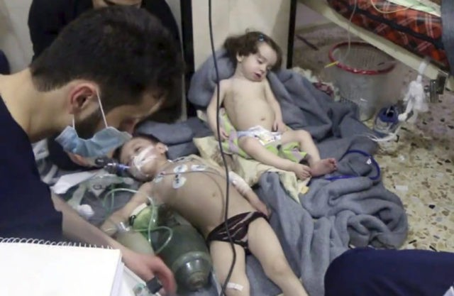 The Latest: Russia denies reports of Syrian chemical attack